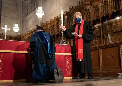 Bishop-in-Residence Ken Carter blesses the dean.